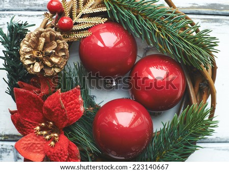 Composition of three red bubbles in Christmas wreath - stock photo