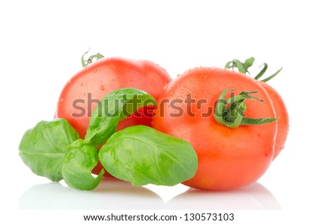Composition of: tomato and basil leaves Isolated on white background. - stock photo