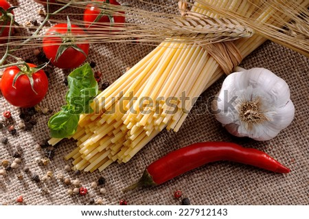 Composition of traditional ingredients for seasoning of a good plate of pasta to the Mediterranean way - stock photo