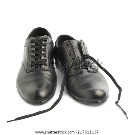 Composition of two classic black leather shoes, one with untied shoelaces, isolated over the white background - stock photo