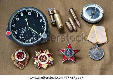 composition of Victory Day. orders, medal, live ammunition, compass, lighter, aviation onboard watch. May 9 - stock photo