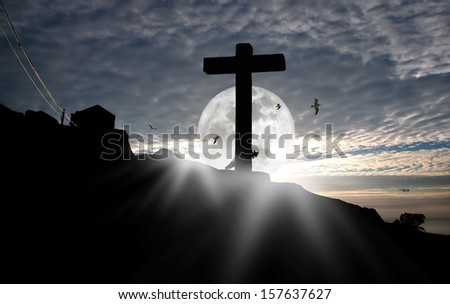 Composition with a stone cross against a beautiful moonrise sky. - stock photo