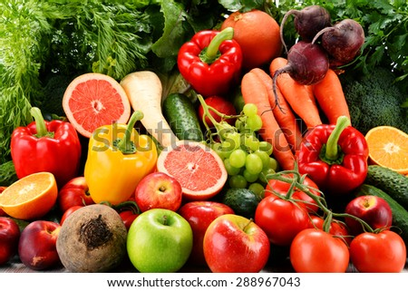 Composition with a variety of organic vegetables and fruits - stock photo