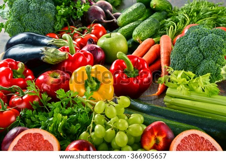 Composition with a variety of organic vegetables and fruits. - stock photo