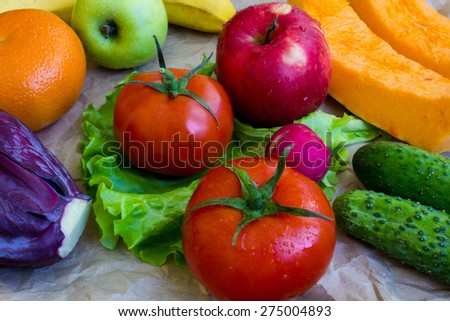 Composition with assorted raw organic vegetables and fruits - stock photo