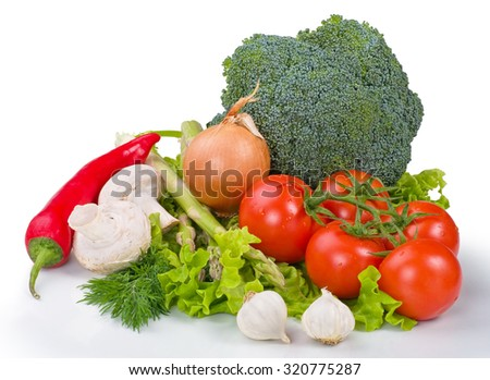 Composition with assorted raw organic vegetables on a white background - stock photo