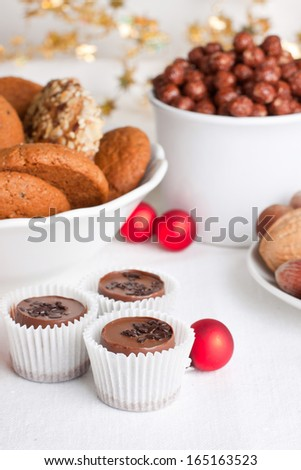 Composition  with assorted sweets and christmas decorations - stock photo