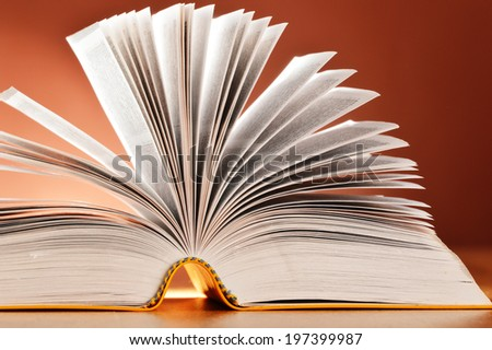 Composition with book on the table - stock photo