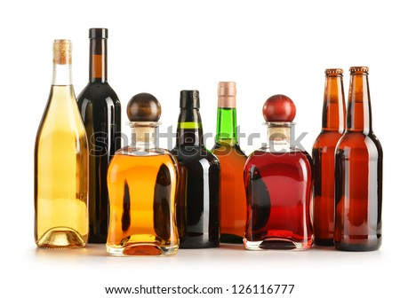 Composition with bottles of assorted alcoholic products isolated on white - stock photo