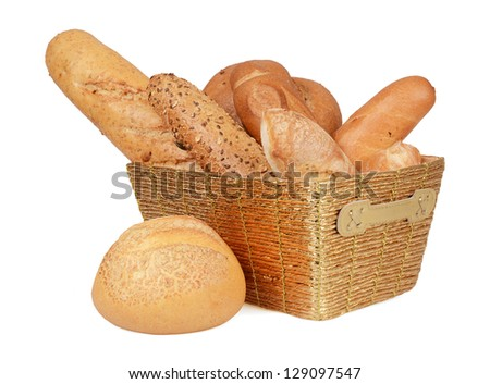 Composition with bread and rolls in golden basket - stock photo