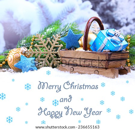 Composition with Christmas decorations in basket on winter background as greeting card - stock photo