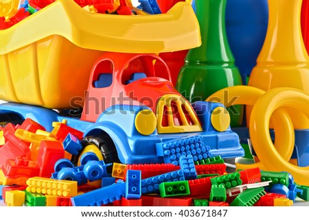 Composition with colorful plastic children toys - stock photo