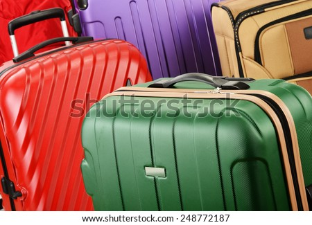 Composition with colorful travel suitcases. - stock photo