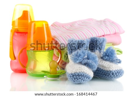 Composition with crocheted booties for baby, isolated on white - stock photo