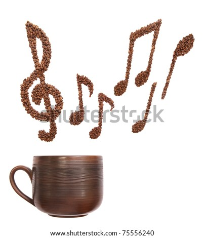 Composition with cup and music notes formed of coffee beans - isolated - stock photo
