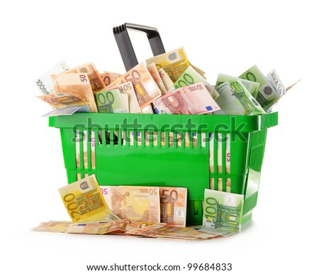 Composition with Euro banknotes in shopping basket. European Union currency - stock photo