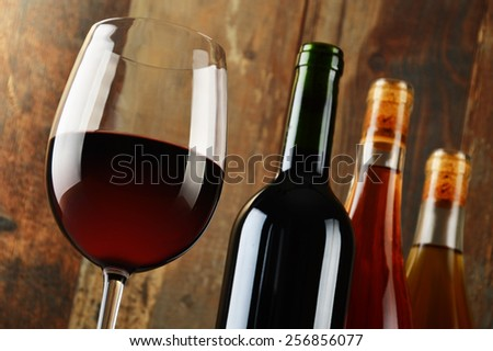 Composition with glass and bottles of wine. - stock photo