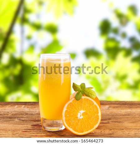 Composition with glass of orange juice  - stock photo
