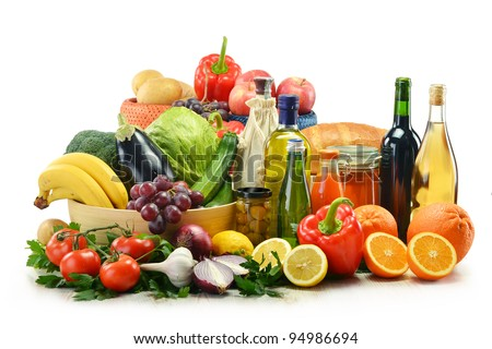 Composition with groceries and wicker basket isolated on white. Vegetables, fruits, wine and bread. - stock photo