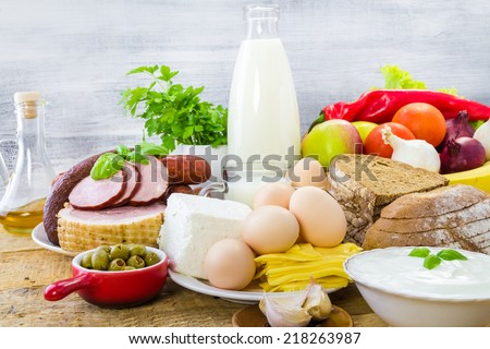 Composition with grocery products including dairy, vegetables, fruits and meat - stock photo