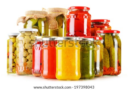Composition with jars of pickled vegetables isolated on white. Marinated food - stock photo