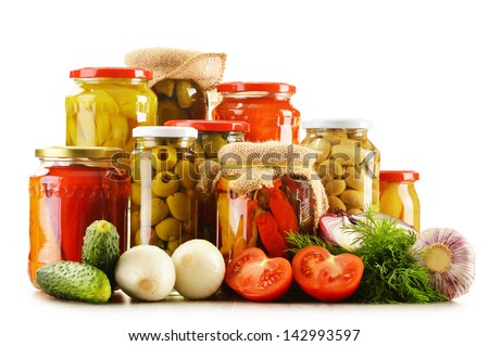 Composition with jars of pickled vegetables. Marinated food - stock photo