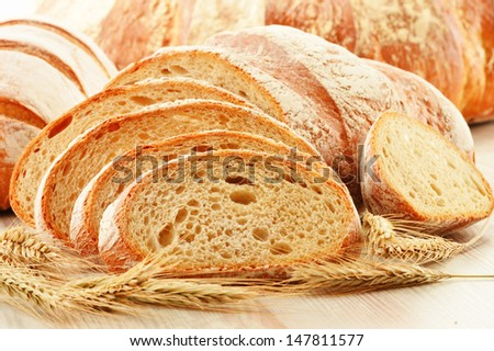 Composition with loafs of bread isolated on white background - stock photo