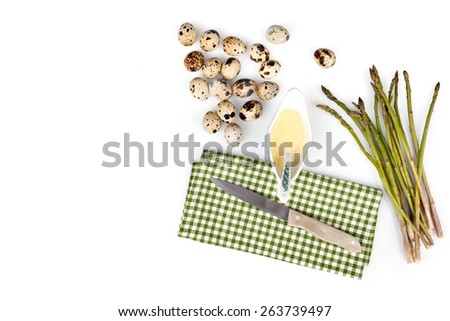 Composition with quail eggs, wild asparagus and mustard mayonnaise over white background, view from above. - stock photo
