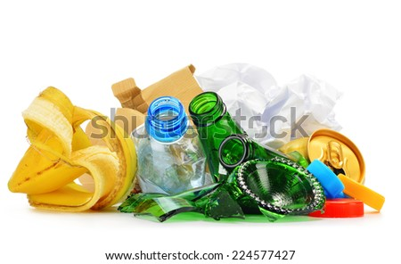 Composition with recyclable garbage consisting of glass, plastic, metal and paper isolated on white background - stock photo