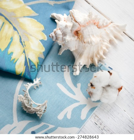 Composition with sea shells and a cotton flower set on cotton towels, relaxation by sea concept - stock photo