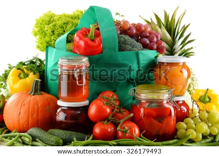 Composition with shopping bag and organic food over white. Balanced diet - stock photo