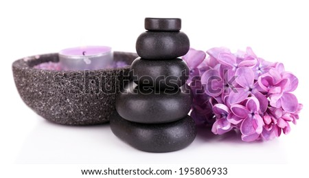 Composition with spa stones and lilac flowers, isolated on white - stock photo