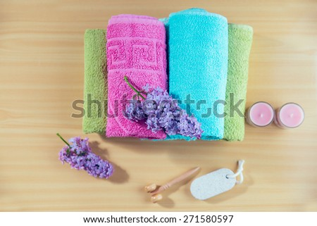 Composition with spa treatment, towels and lilac flowers, - stock photo
