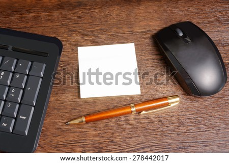 Composition with sticker,  mouse, pen and keyboard laying on wooden desk - stock photo