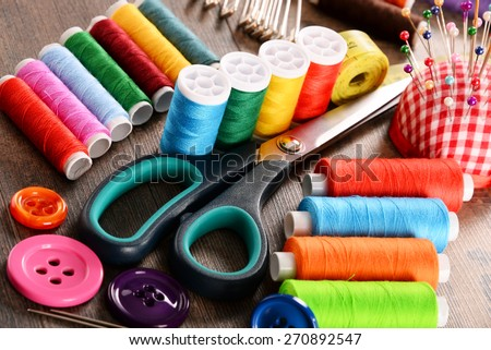 Composition with tailor accessories on wooden table - stock photo