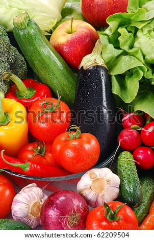 Composition with variety of raw vegetables - stock photo