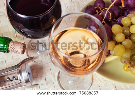 Composition with white and red wine - stock photo