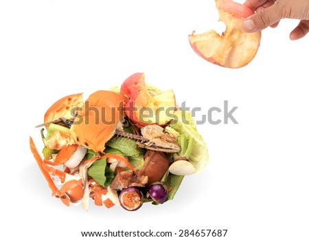 Composting pile of rotting kitchen fruits and vegetable scraps as a banana peel orange and onion garbage waste for recycling as an environmentally responsible compost that enriches soil in a garden.   - stock photo
