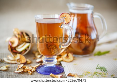 compote of dried fruits in a glass cup on a table - stock photo