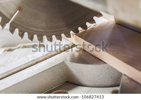 Compound Mitre Saw cutting planks - stock photo
