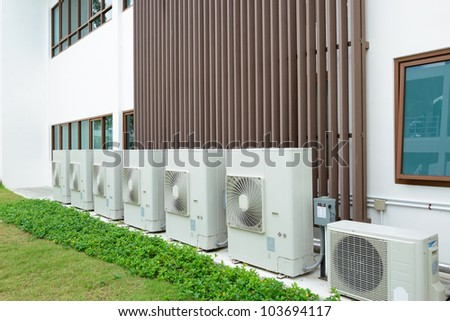Compressor of air condition are set next to the building. - stock photo