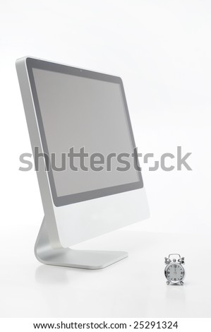 computer and alarm clock against white background - stock photo