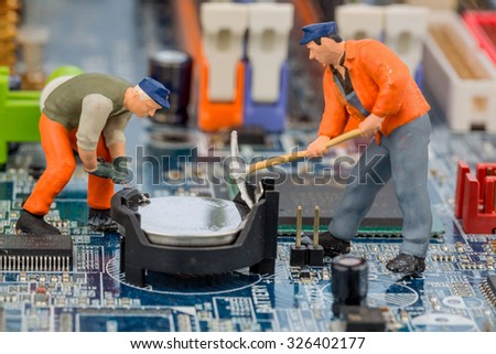 computer board and worker, symbol photo for computer failure, maintenance, data security - stock photo