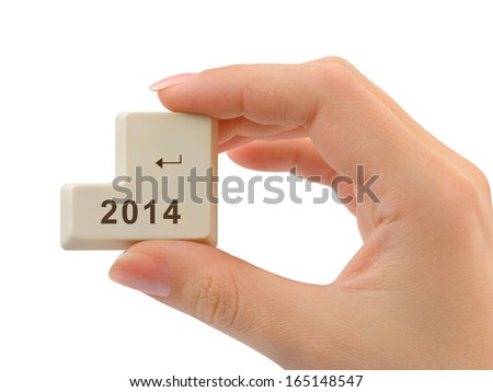 Computer button 2014 in hand isolated on white background - stock photo