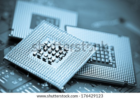 computer cpu (central processor unit) chip on mainboard - stock photo