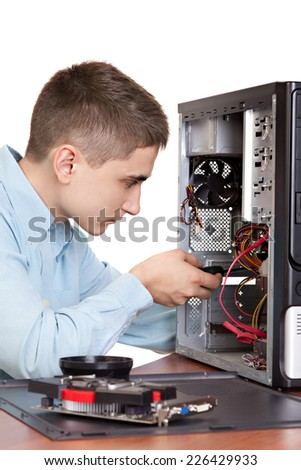 Computer engineer working at open Pc - stock photo