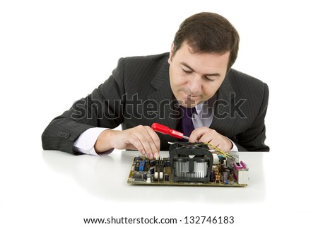 Computer Engineer working in a motherboard, isolated - stock photo