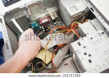 Computer engineer working on broken cpu in his office - stock photo