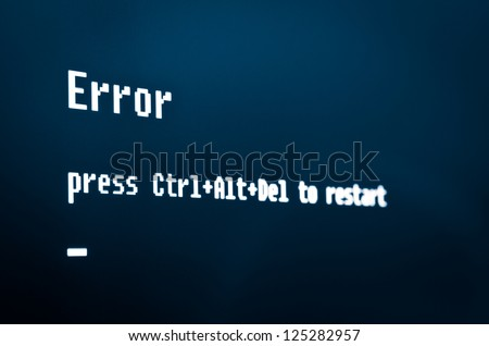 "Computer error message  ""Error, press Ctrl + Alt + Del to restart"" High detailed computer screen photo. - stock photo"