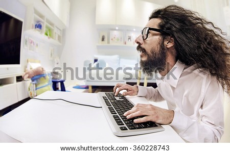 Computer geek portrait with keyboard and eyeglasses - stock photo